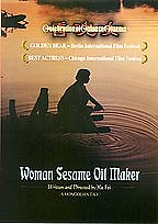 Woman Sesame Oil Maker
