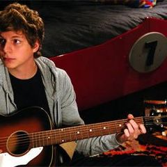 Michael Cera with a guitar