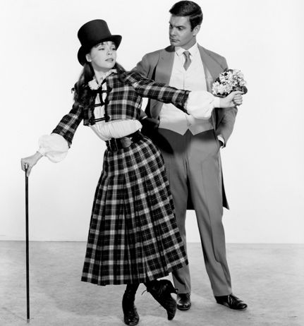 Louis Jourdan and Leslie Caron