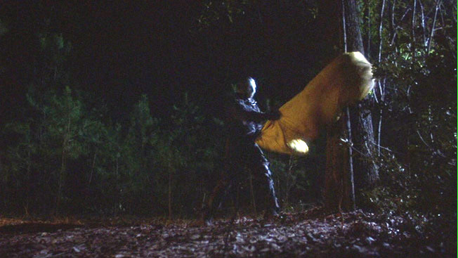 ...VII: The New Blood - The famous sleeping bag against the tree.  VS.